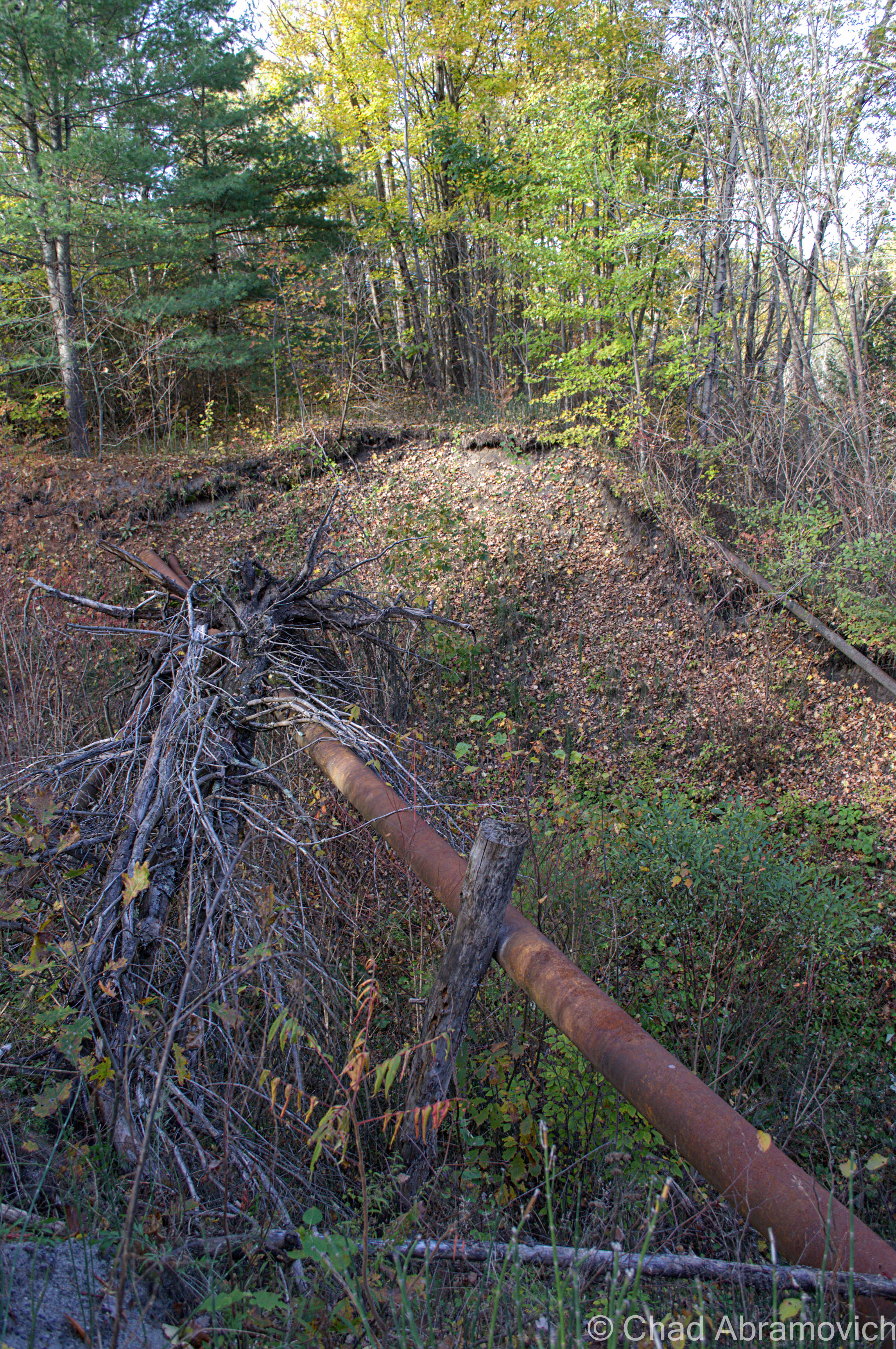 the washout had exposed old rusted pipes that were left exposed and dangling over the gap. climbing up and down the banks was terrible, as the earth kept sliding beneath our feet.