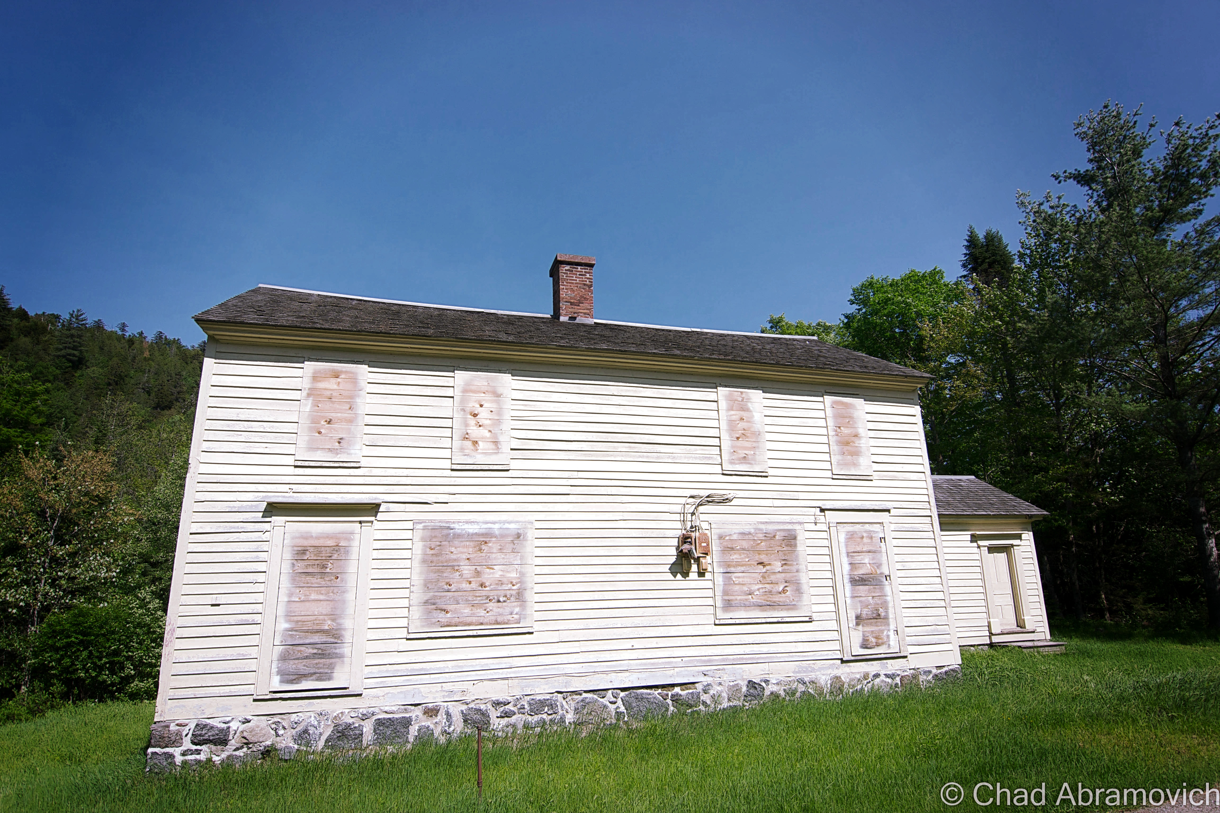 """MacNaughton Cottage (1845). This was the house that Vice President Theodore Roosevelt stayed in during his hike to Mount Marcy when he received news of President William McKinley being close to death after being shot in Buffalo, and is the only """"restored"""" building in Tawahus."""
